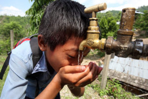 boy_drinks_from_a_tap_at_a_newah_wash_water_project_10677785345